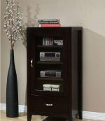 Ikcco Audio Cabinet, Store and protect your stereo in this Axium espresso audio cabinet. Three adjustable shelves behind an elegant glass door offer room for your audio components and media collection, and a lower drawer provides ample storage for cords and peripherals